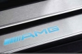 AMG door sill panels, Models from 03/2006, blue-backlit, 4-piece, appointment colour black, x 2
